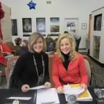 Happy faces greet competitors at registration (Kim Johnson and Angela Patrick).