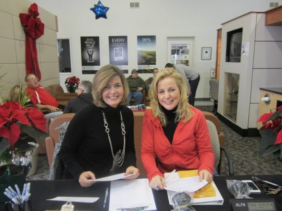 Happy faces greet competitors at registration (Kim Johnson and Angela Patrick).